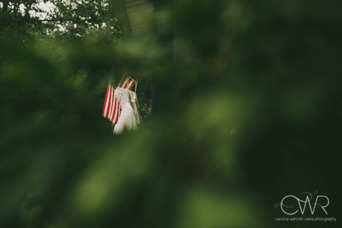 wedding dress and american flag through trees