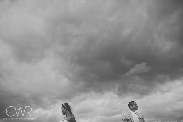 Manasquan beach bride and groom portrait in front of stormy clouds