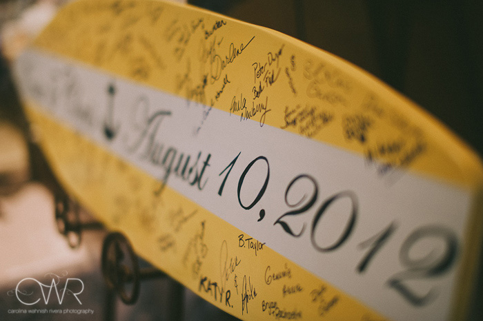 Wedding at Crystal Point Yacht Club: surf board sign in board
