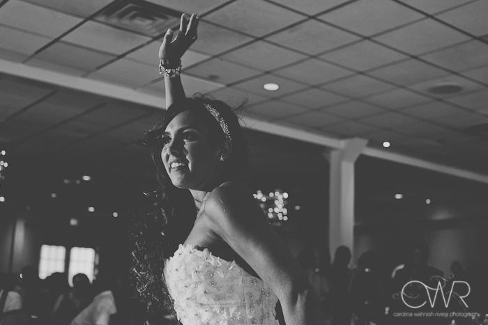 Wedding at Crystal Point Yacht Club: bride dancing