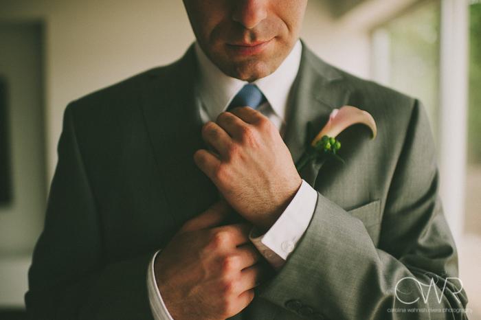 Lake House Inn Perkasie PA Wedding: groom fixing tie