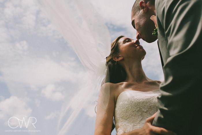 Lake House Inn Perkasie PA Wedding: bride and groom kissing against clear sky