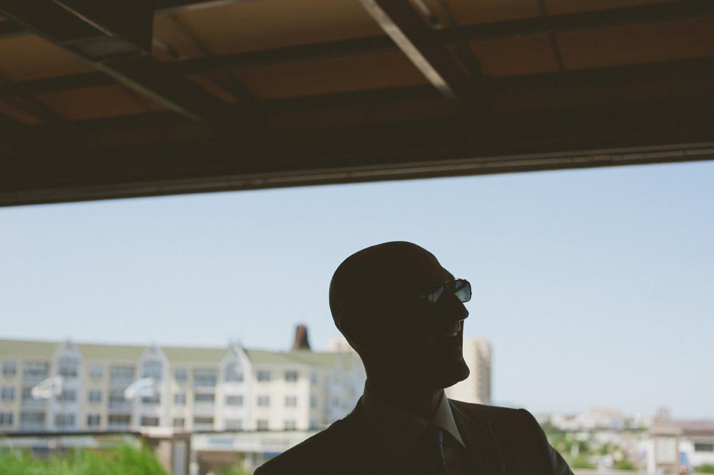 beach wedding photographer silhouette against blue sky beach setting in NJ