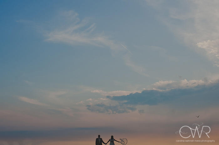 NJ Trash the dress session:bride and groom small on horizon