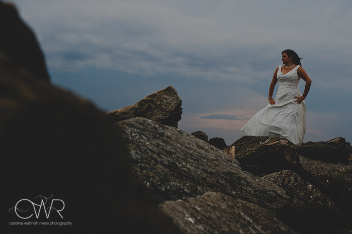 NJ Trash the dress session: bride on rock by stormy clouds