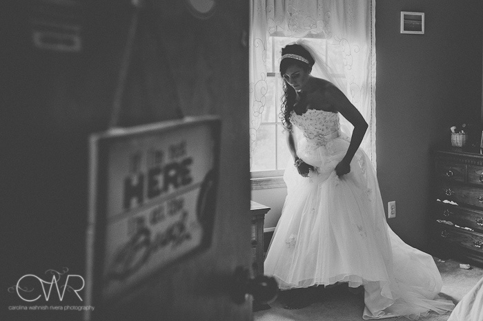 bride getting ready in old bedroom