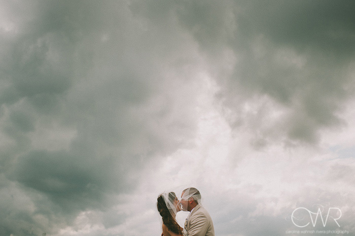 Manasquan beach romantic bride and groom portrait in front of storm clouds