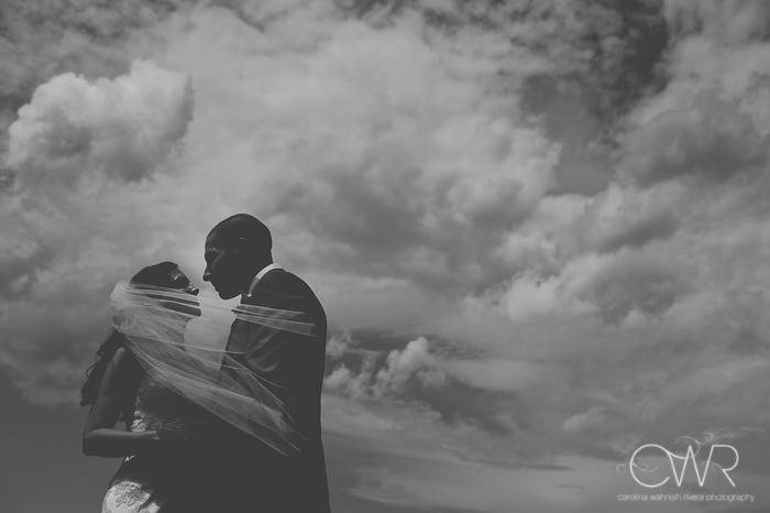 Lake House Inn Perkasie PA Wedding: bride and groom black and white against dark clouds