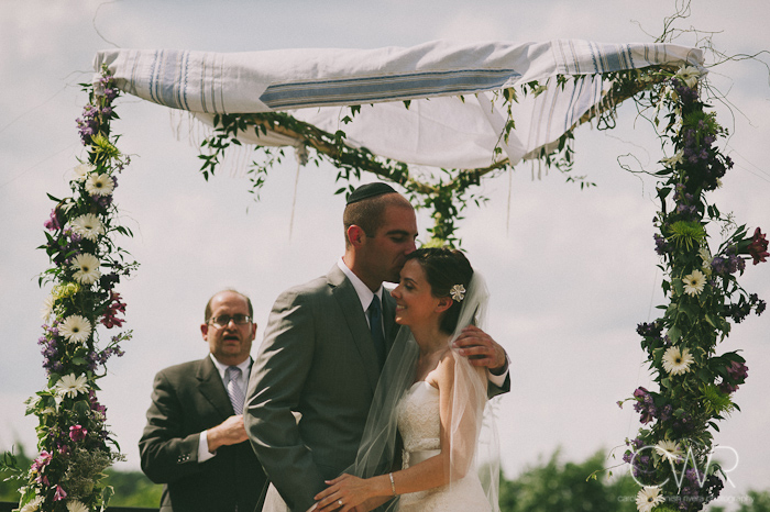 Jewish wedding ceremony at the Lake house Inn Perkasie PA: bride and groom kissing