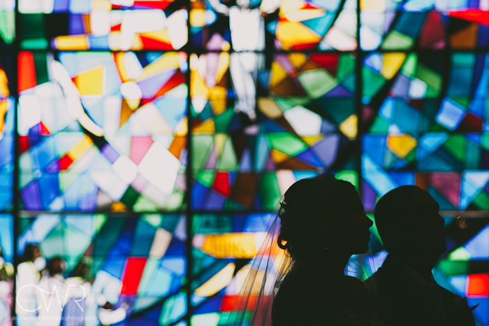 Church of Saint Margaret Morristown NJ Wedding: bride and groom in front of stained glass