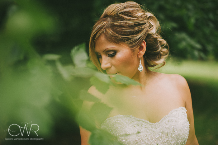 Olde Mill Inn Basking Ridge NJ Wedding: artistic bridal portrait looking down by trees