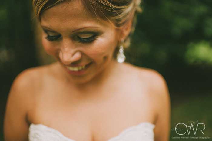 Olde Mill Inn Basking Ridge NJ Wedding: bride laughing and looking down