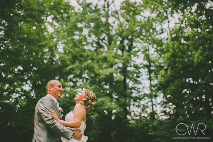 Olde Mill Inn Basking Ridge NJ Wedding: bride and groom laughing together by trees