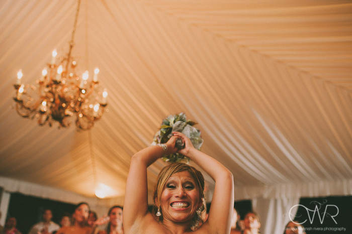 Olde Mill Inn Basking Ridge NJ Wedding: bride laughing and throwing bouquet