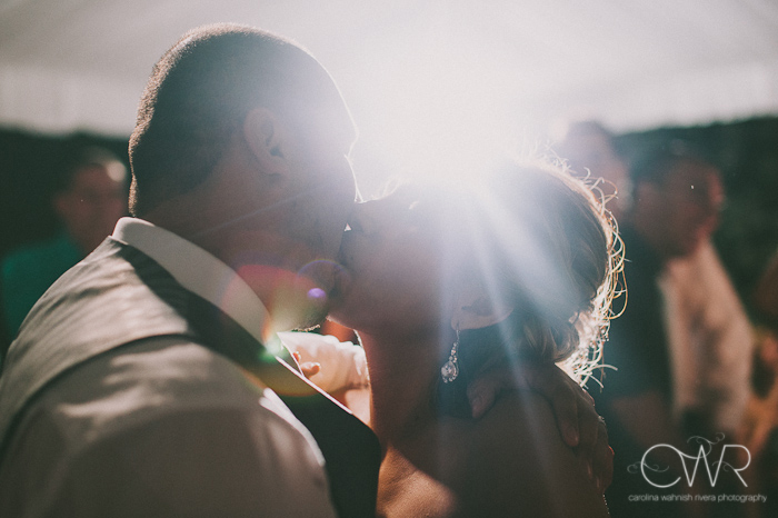 Olde Mill Inn Basking Ridge NJ Wedding: bride and groom kissing with light