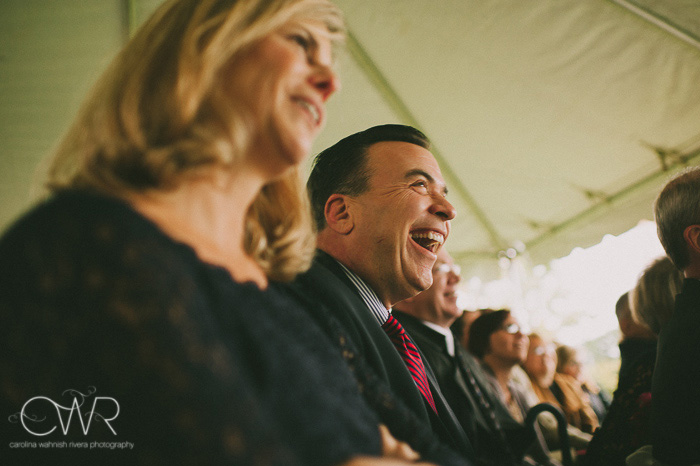 tented wedding in old chatham ny, guests laugh during vows