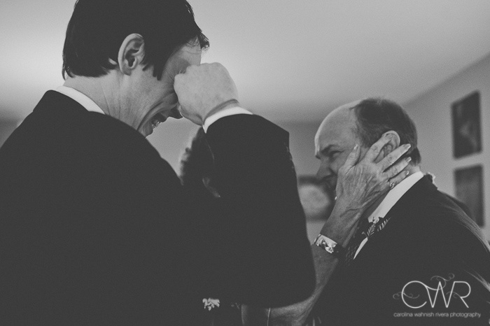 artistic wedding photos in black and white of emotional moment between groom and father
