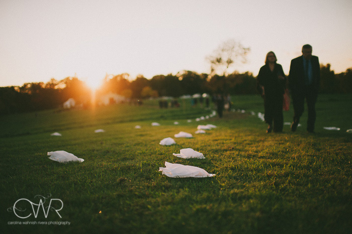 backyard wedding photography trail to reception tent as sun sets