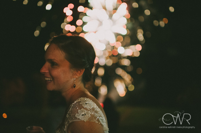 candid wedding photography moment of bride and fireworks in background