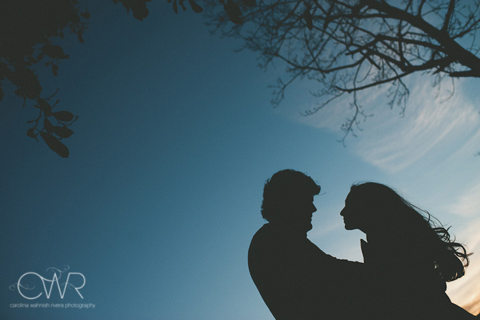 creative engagement photos silhouette of couple under bright blue sky for their Boston wedding