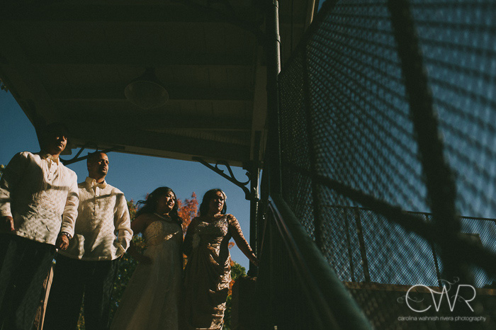 creative wedding photos of bridal party at glen ridge train station in nj