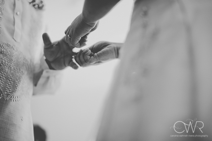 black and white image of interracial wedding ceremony exchange of rings