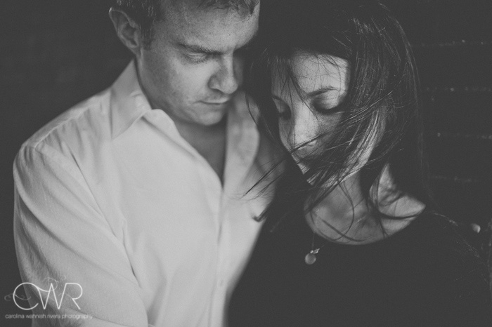 sexy engagement photos in black and white of couple embracing