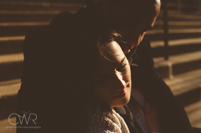 nyc interracial wedding photography - engagement photo of couple in dramatic lighting in soho nyc
