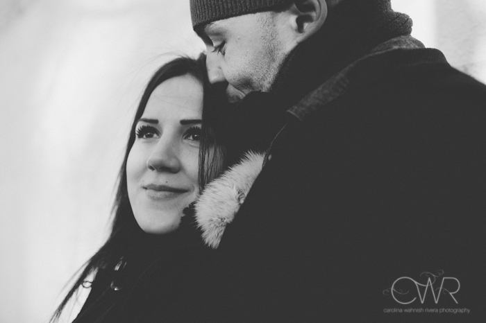 nyc interracial wedding photography, black and white engagement photo of couple bundled up in winter