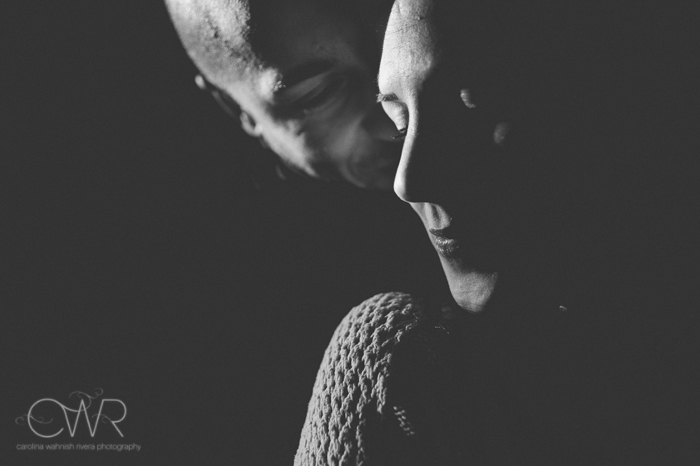 nyc fine art wedding photographer, fine art black and white engagement photo of groom whispering into bride's ear