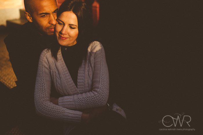 soho nyc engagement photos - sunkissed photo of interracial couple embracing in nyc engagement session