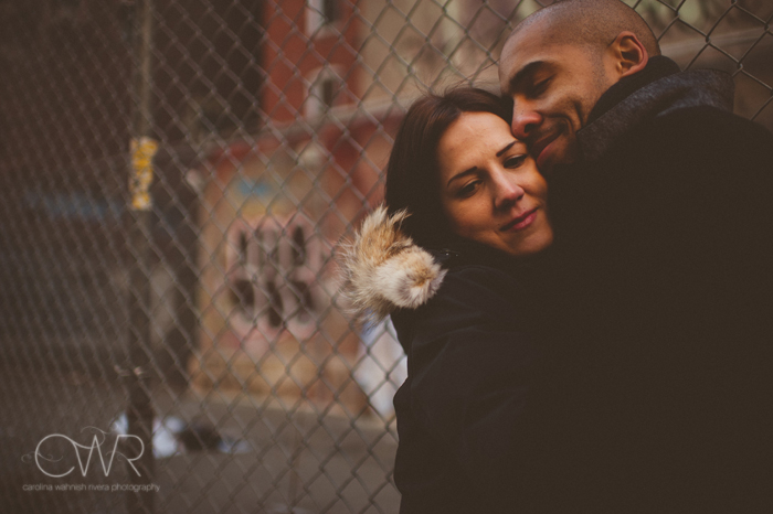 urban nyc engagement session - interracial couple kissing in urban environment in soho nyc