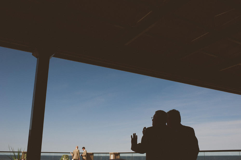 summer wedding on the rooftop of Avenue in Long branch while guests overlook ceremony