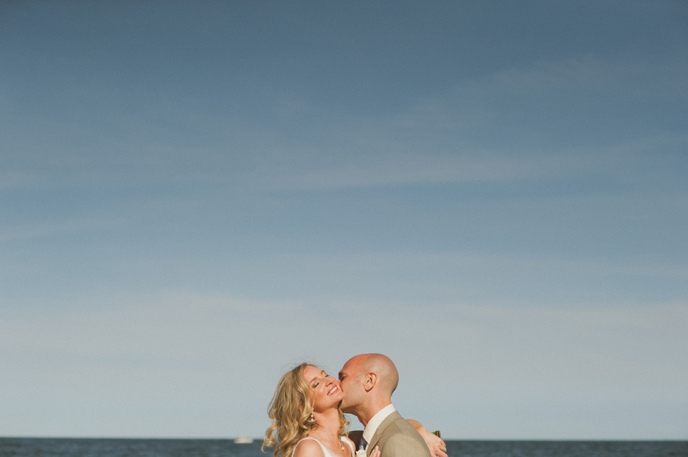 Avenue Long Branch Wedding portrait of bride and groom on beach against blue sky