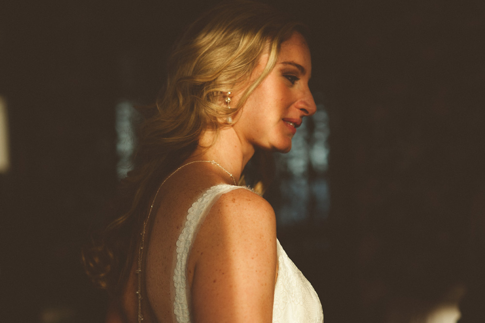 summer wedding photo of bride delicately lit by sun