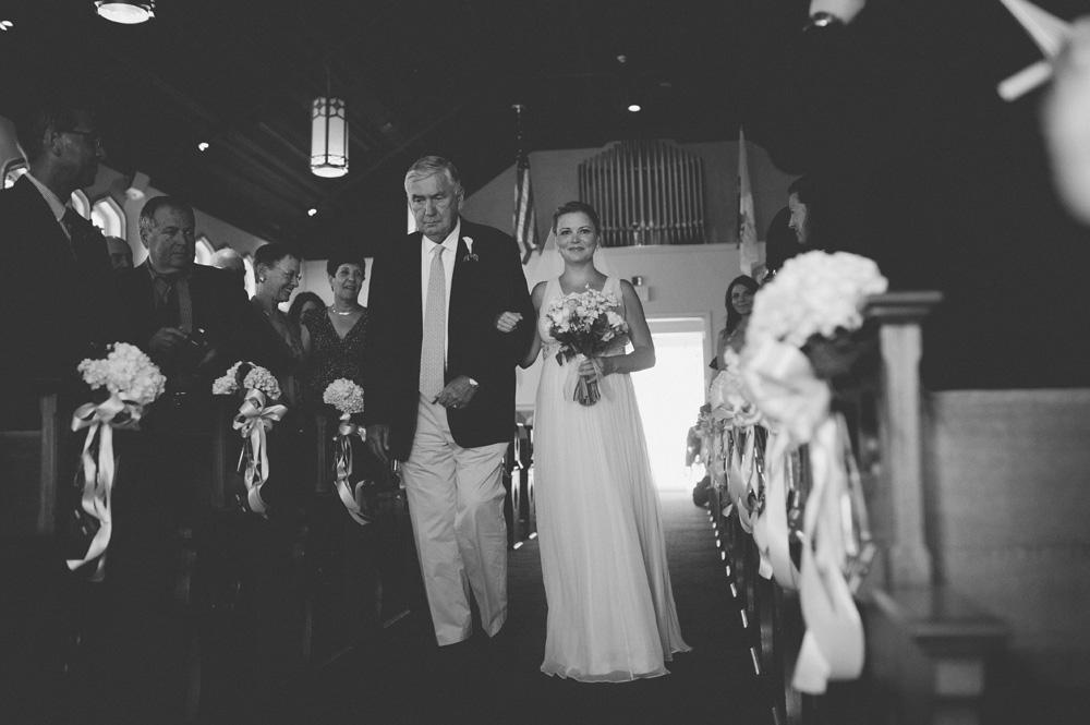 NY Wedding small cute church reception photo in black and white of bride walking down the aisle