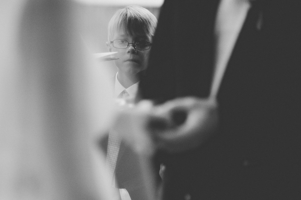 romantic weddings photo in black and white of little boy during ring exchange