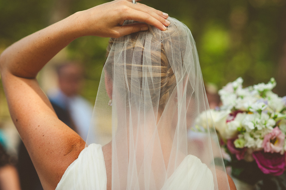 romantic weddings in ny set in the fall, bride holding onto veil