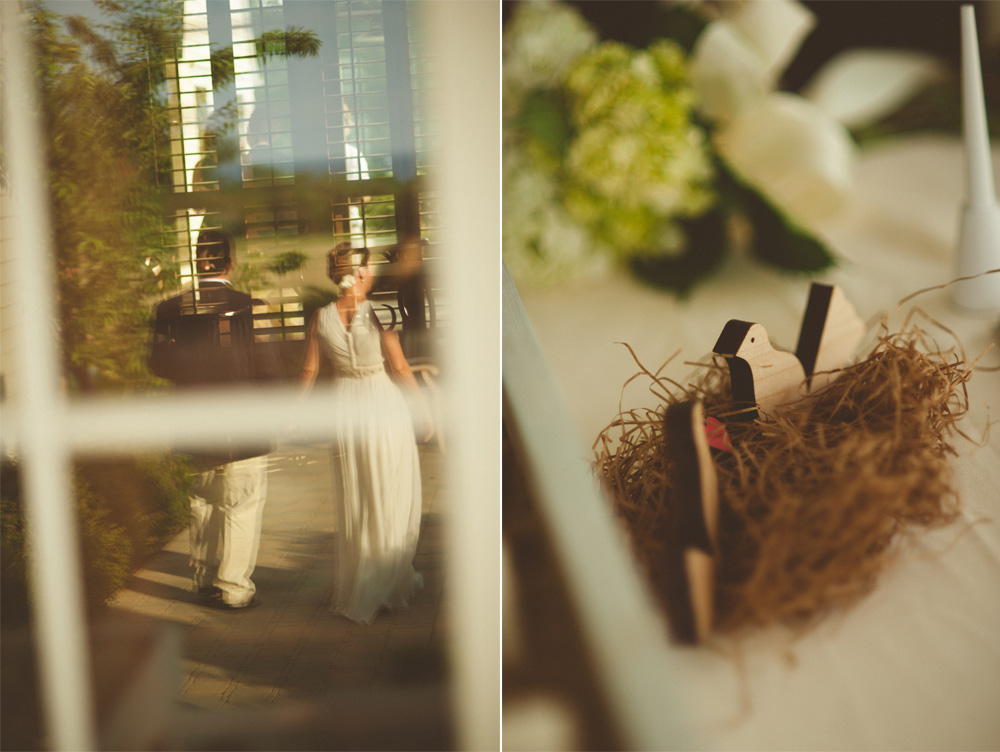 creative wedding photo of couple walking away in reflection and vintage wedding decorations