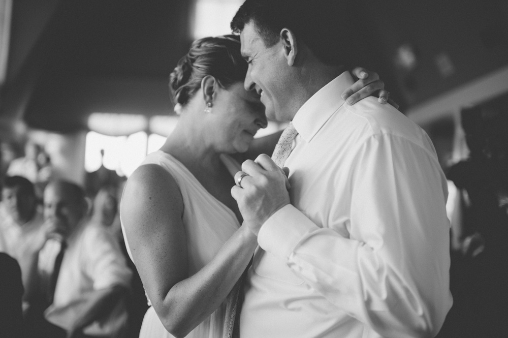 creative wedding photo in black and white of emotional moment between couple during first dance