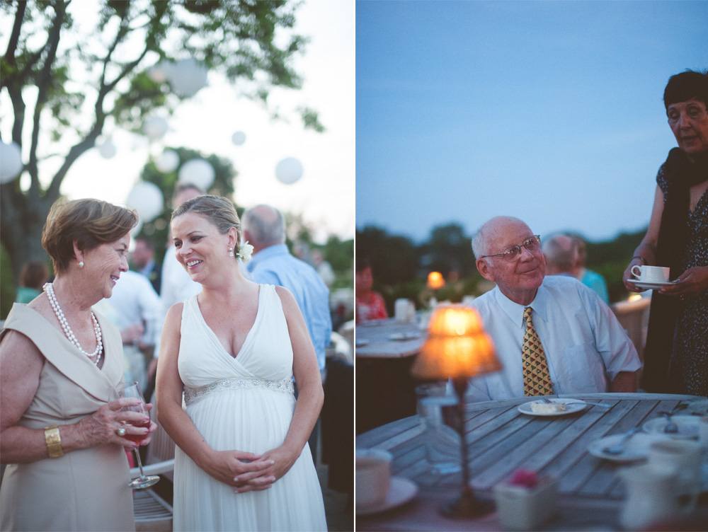 candid wedding photography moments between bride and guests at dusk