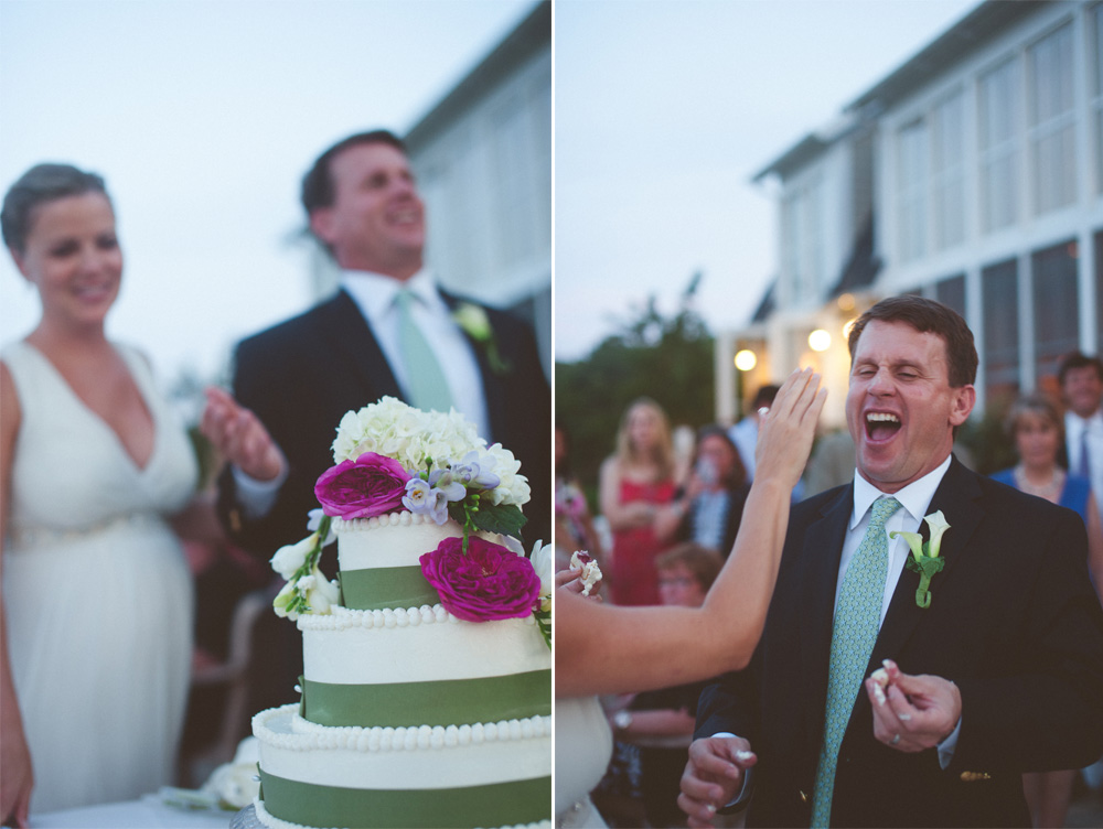 candid wedding photography cake fun cutting moment between bride and groom