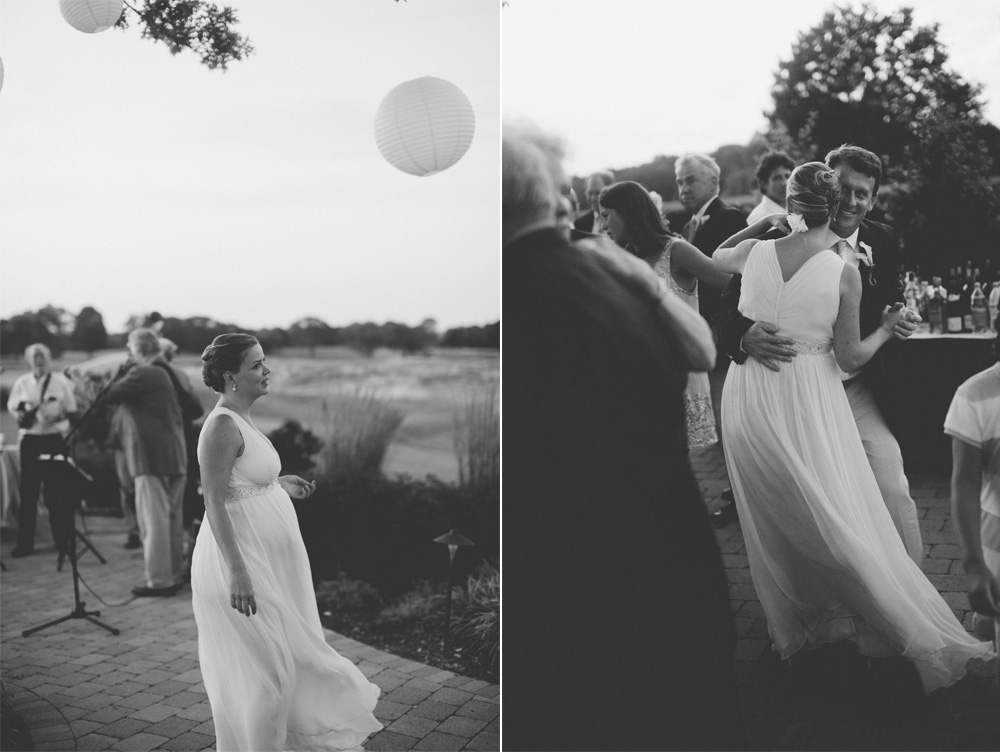 candid wedding photography in black and white of outdoor dancing at dusk