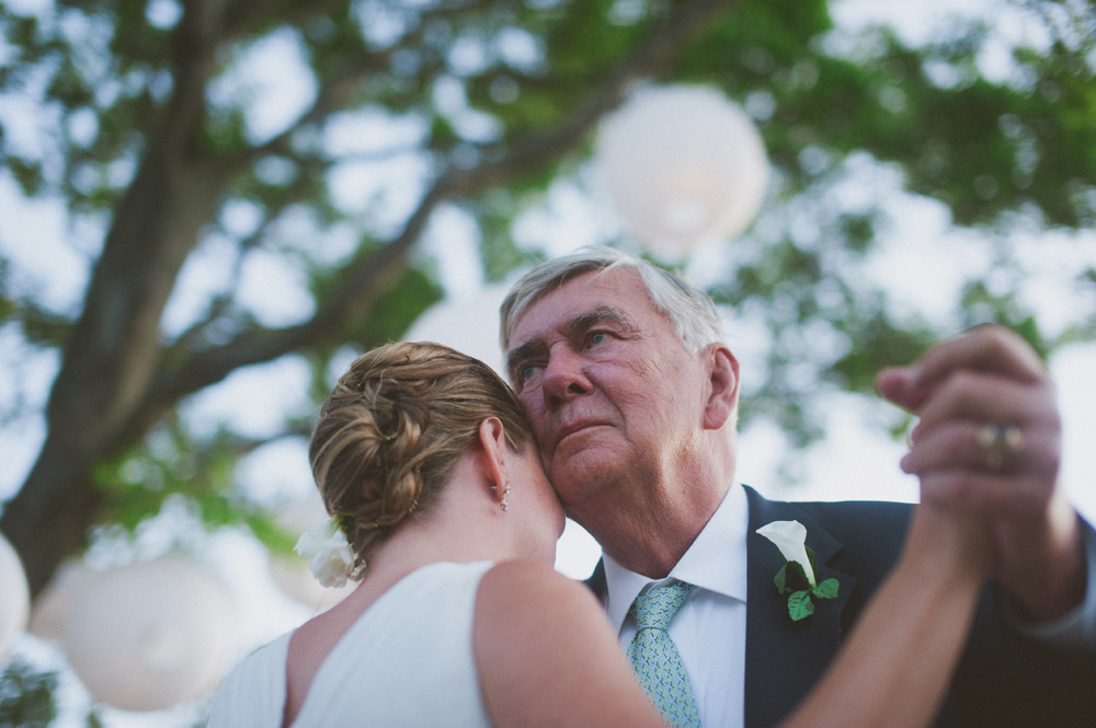 candid wedding photography emotional moment between bride and father