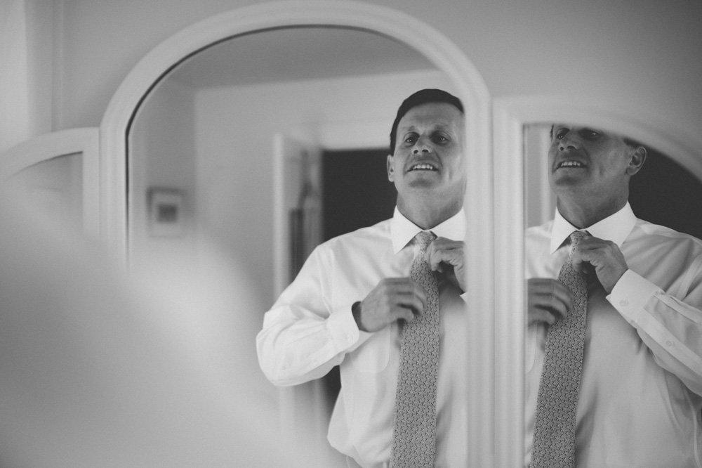 NY Wedding groom gets ready at quaint bed and breakfast on Shelter Island