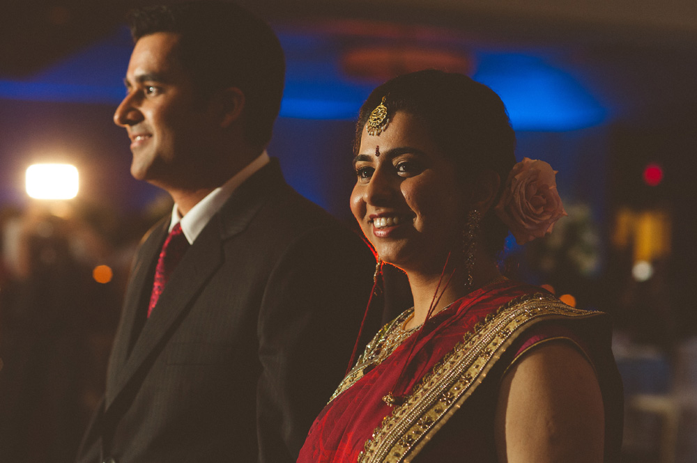 indian wedding photography capturing speech of bride and groom during reception at Parsippany NJ Hilton