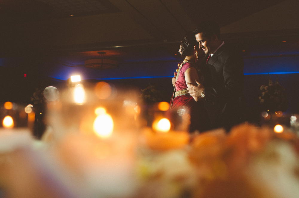 creative Indian wedding photos capturing first dance between bride and groom in reception at Hilton in Parsippany NJ
