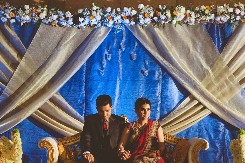 one of many Indian wedding photos of bride and groom on stage during reception at Hilton Hotel in New Jersey