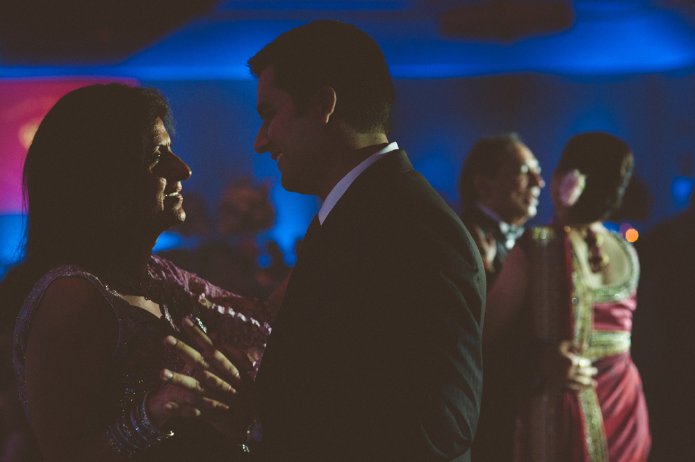 sikh wedding photography capturing first dances between parents and bride and groom during wedding reception at hilton in parsippany