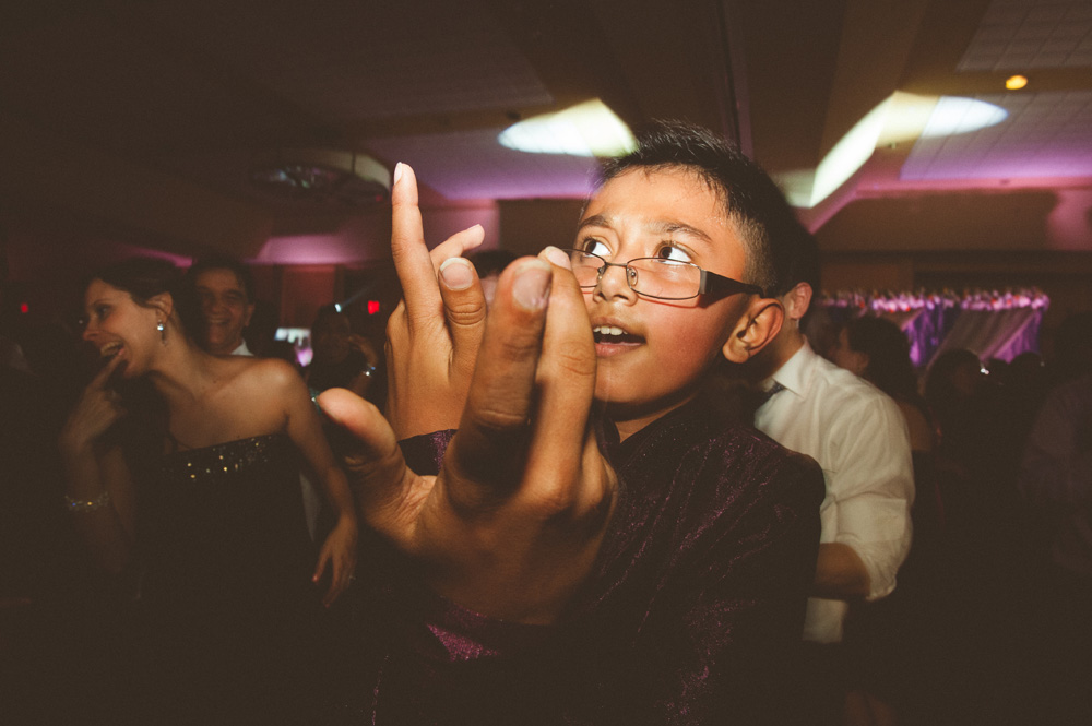 little boy dancing in creative wedding photography